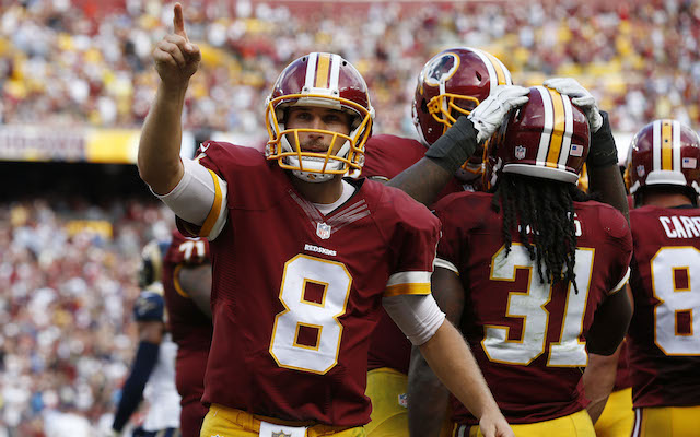 Sep 20, 2015; Landover, MD, USA; Washington Redskins quarterback Kirk Cousins (8) celebrates after a touchdown by Redskins running back Matt Jones (31) against the St. Louis Rams in the fourth quarter at FedEx Field. The Redskins won 24-10. Mandatory Credit: Geoff Burke-USA TODAY Sports