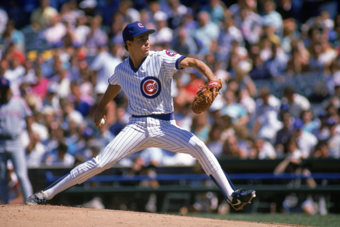 Greg Maddux winds back to pitch