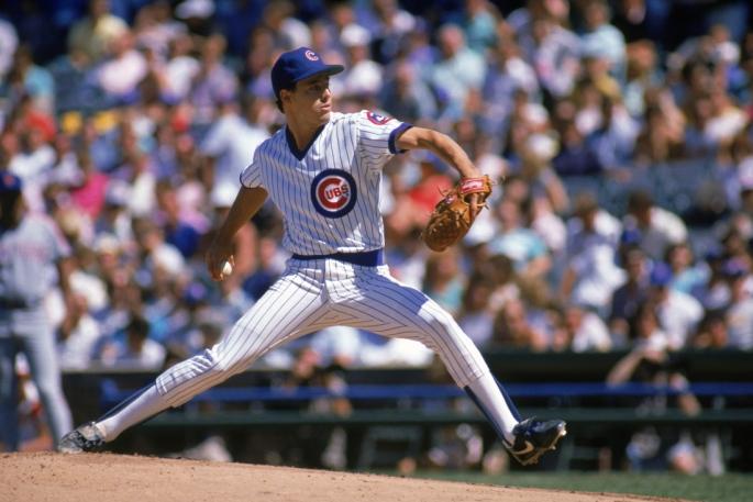 Greg Maddux winds back to pitch